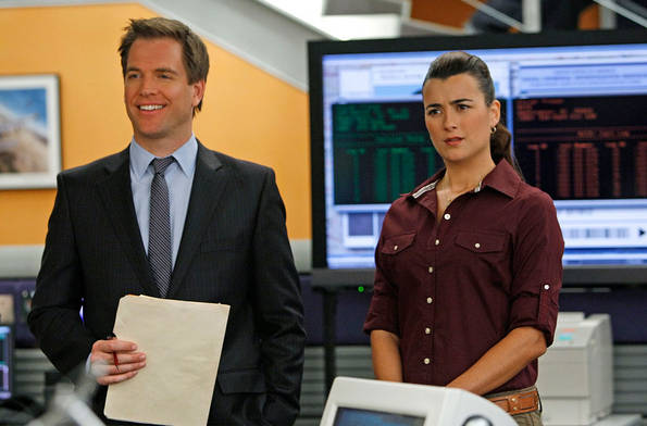NCIS discovers that one of its former investigative assistants found brutally stabbed to death was selling details for how to rob a warehouse full of valuable possessions belonging to a woman convicted of fraud. Meanwhile, a new special agent joins the office, on NCIS. Episode directed by series star Michael Weatherly (left). Also pictured Cote de Pablo. Photo: Cliff Lipson/CBS