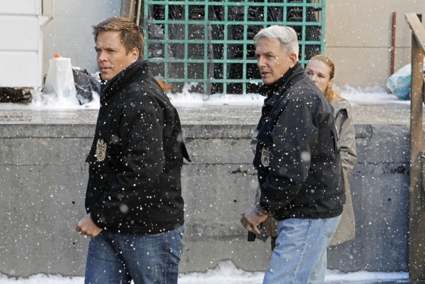 Special Agents Anthony DiNozzo (Michael Weatherly) and Leroy Jethro Gibbs (Mark Harmon) brave the snow on NCIS. Photo: Sonja Flemming/CBS ©2011 CBS Broadcasting Inc. All Rights Reserved.