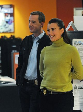 Special Agents Ziva David (Cote de Pablo) and Timothy McGee (Sean Murray) share a laugh at work, on NCIS. Photo: Ron P. Jaffe/CBS © 2011 CBS Broadcasting, Inc. All Rights Reserved.