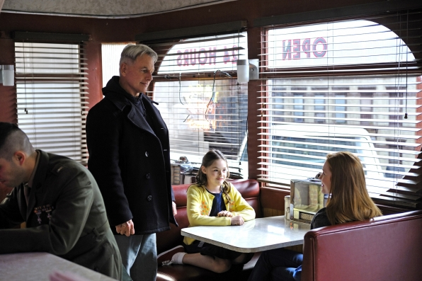 During a routine stop for his morning coffee, Gibbs finds himself face-to-face with the barrel of a gun, which forces him to question choices he has made in the past and present, on the 200th episode of NCIS. Pictured left to right: Mark Harmon, Darby Stanchfield (Shannon) and Sam Schuder (Kelly) Photo: Richard Foreman/CBS ©2012 CBS Broadcasting Inc. All Rights Reserved.