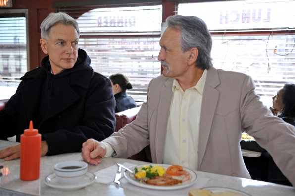 During a routine stop for his morning coffee, Gibbs finds himself face-to-face with the barrel of a gun, which forces him to question choices he has made in the past and present, on the 200th episode of NCIS. Pictured left to right: Mark Harmon and Muse Watson Photo: Richard Foreman/CBS ©2012 CBS Broadcasting Inc. All Rights Reserved.