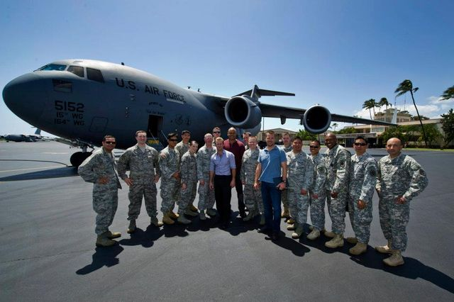 Actors Chris O'Donnell, LL Cool J, and Scott Caan of NCIS Los Angeles, and Hawaii Five-0 pose for a group photo with U.S. Air Force Airmen and Hawaii Army National Guard Soldiers the filming of an Hawaii Five-0 episode at Joint Base Pearl Harbor-Hickam on March 26, 2012. The Airmen and Soldiers participated as background extras during filming. (Department of Defense photo by U.S. Air Force Tech. Sgt. Michael R. Holzworth/Released) Public Domain